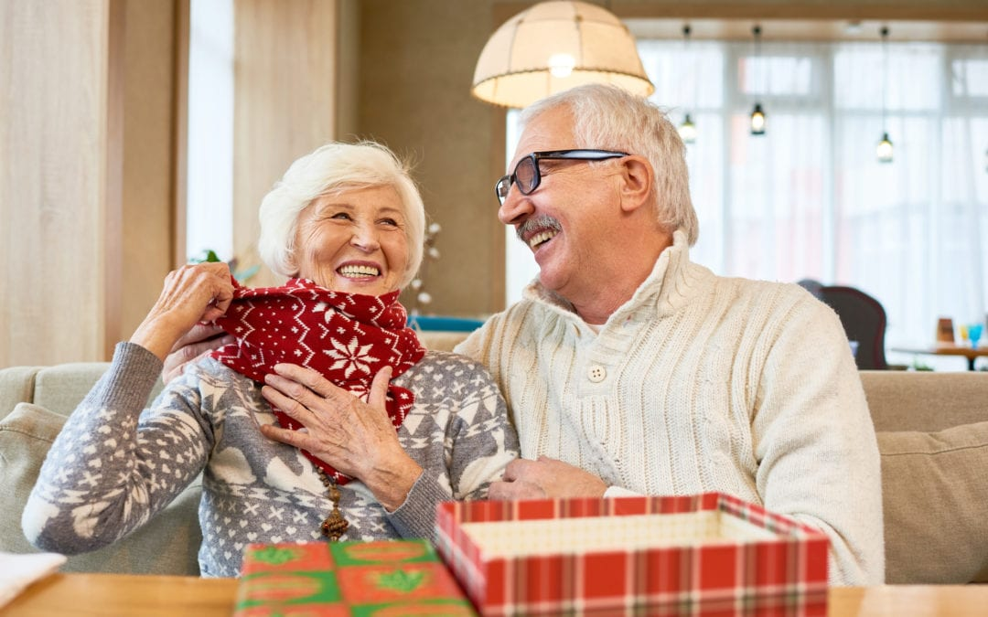 Winter Care Tips For Hearing Aid Users | old couple laughing | Physician Hearing Care Tennessee