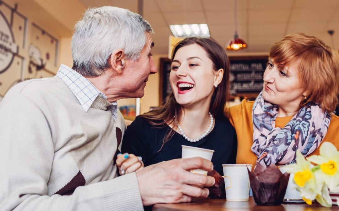 Happy family spending time together. Senoir family couple with adult daughter chat and laugh in cafe. Family values | PHC Tennnesse