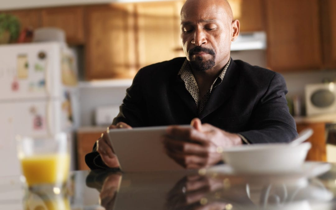 mature african man with tablet in kitchen and breakfast   PHC Tennessee