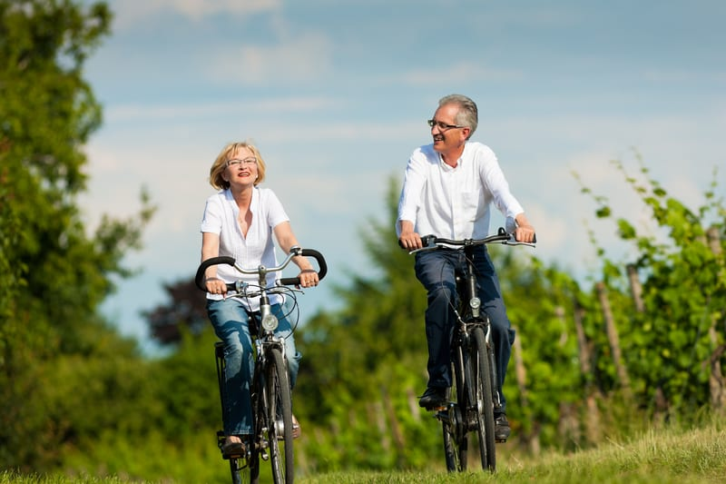 happy-senior-couple-cycling-outdoors-in-summer | PHC Tennessee