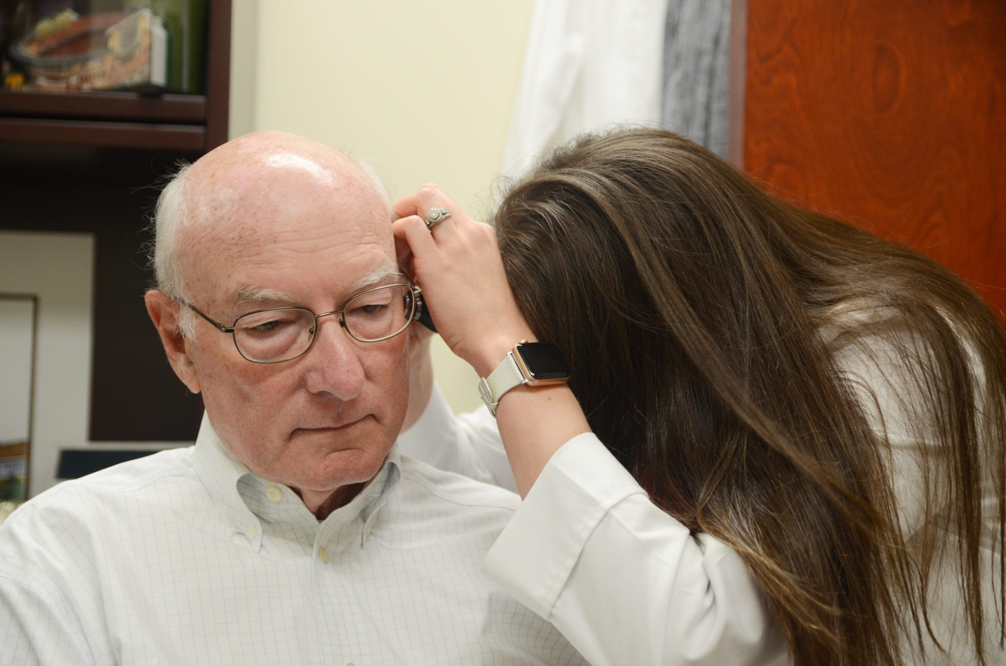 Man during hearing aid fitting