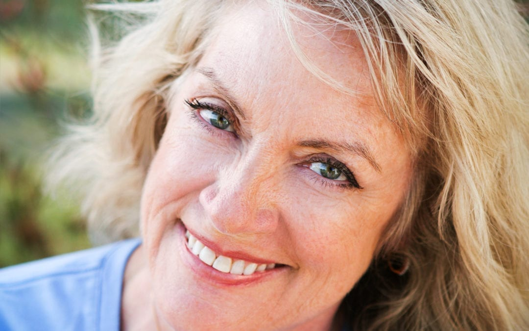 happy middle aged woman smiling into camera