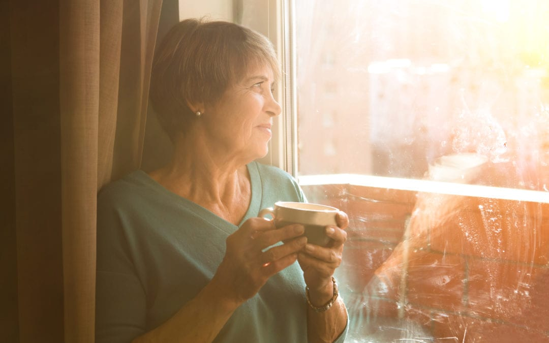 Senior woman looking at the window | Scottsdale ENT