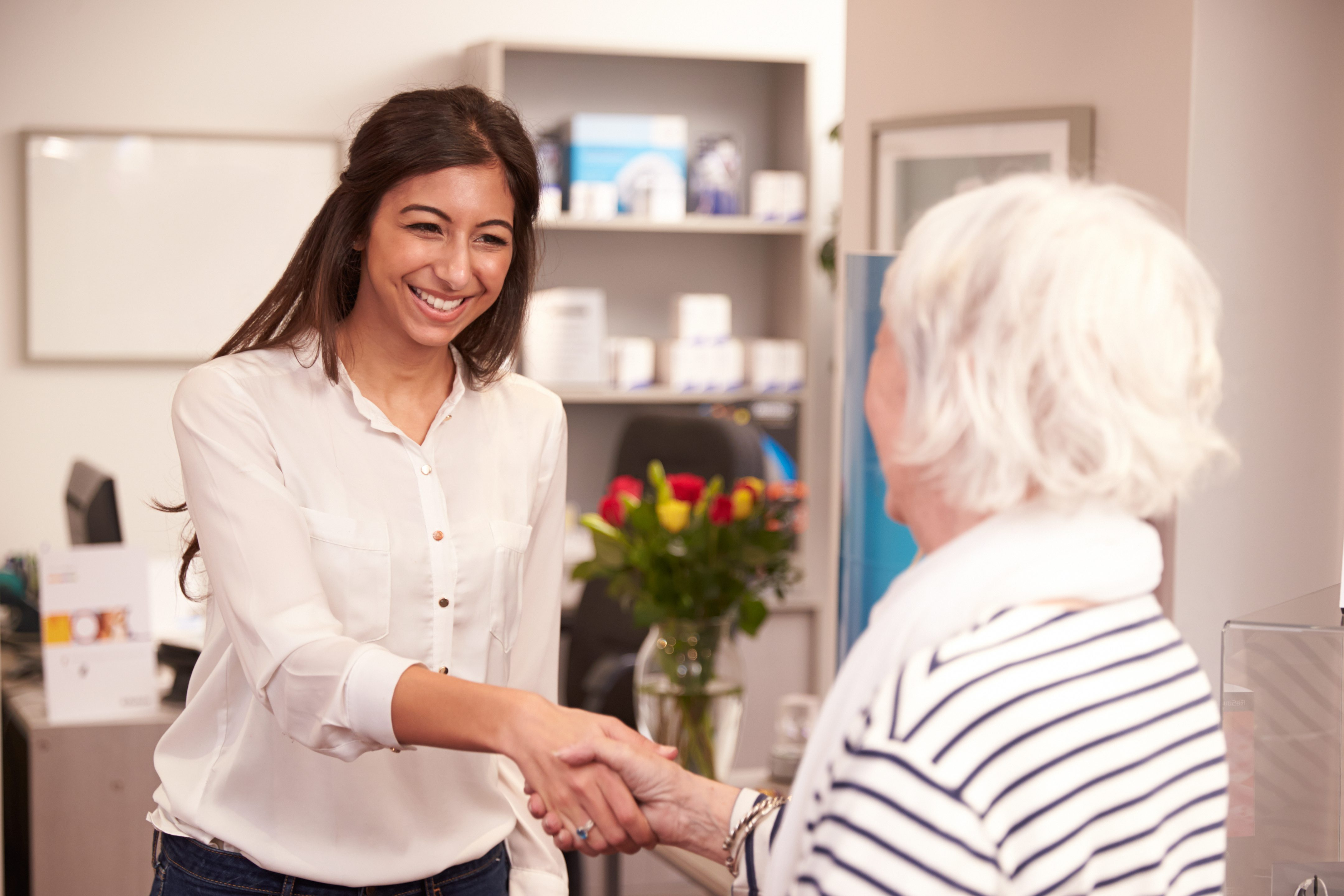 receptionist greeting female patient at hearing clinic | Scottsdale ENT