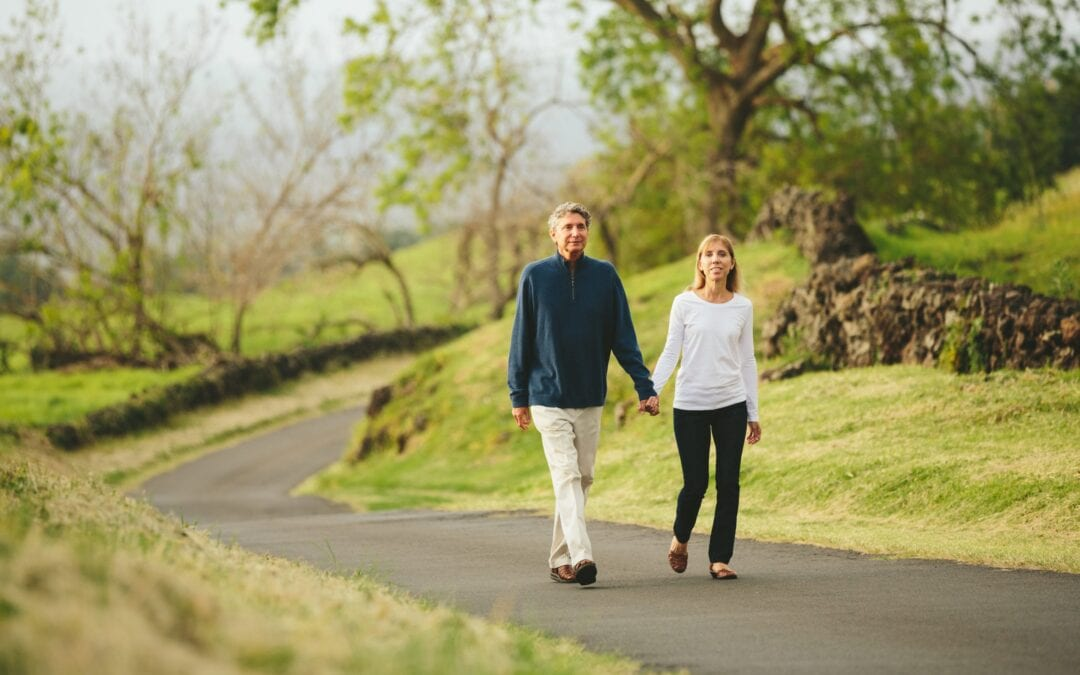 couple walking hand in hand | Beltone hearing