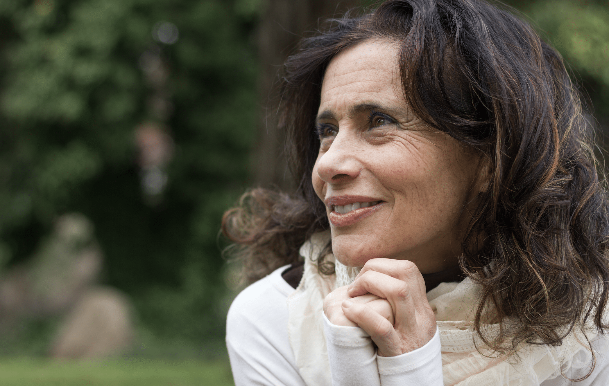 Middle aged lady smiling away from camera