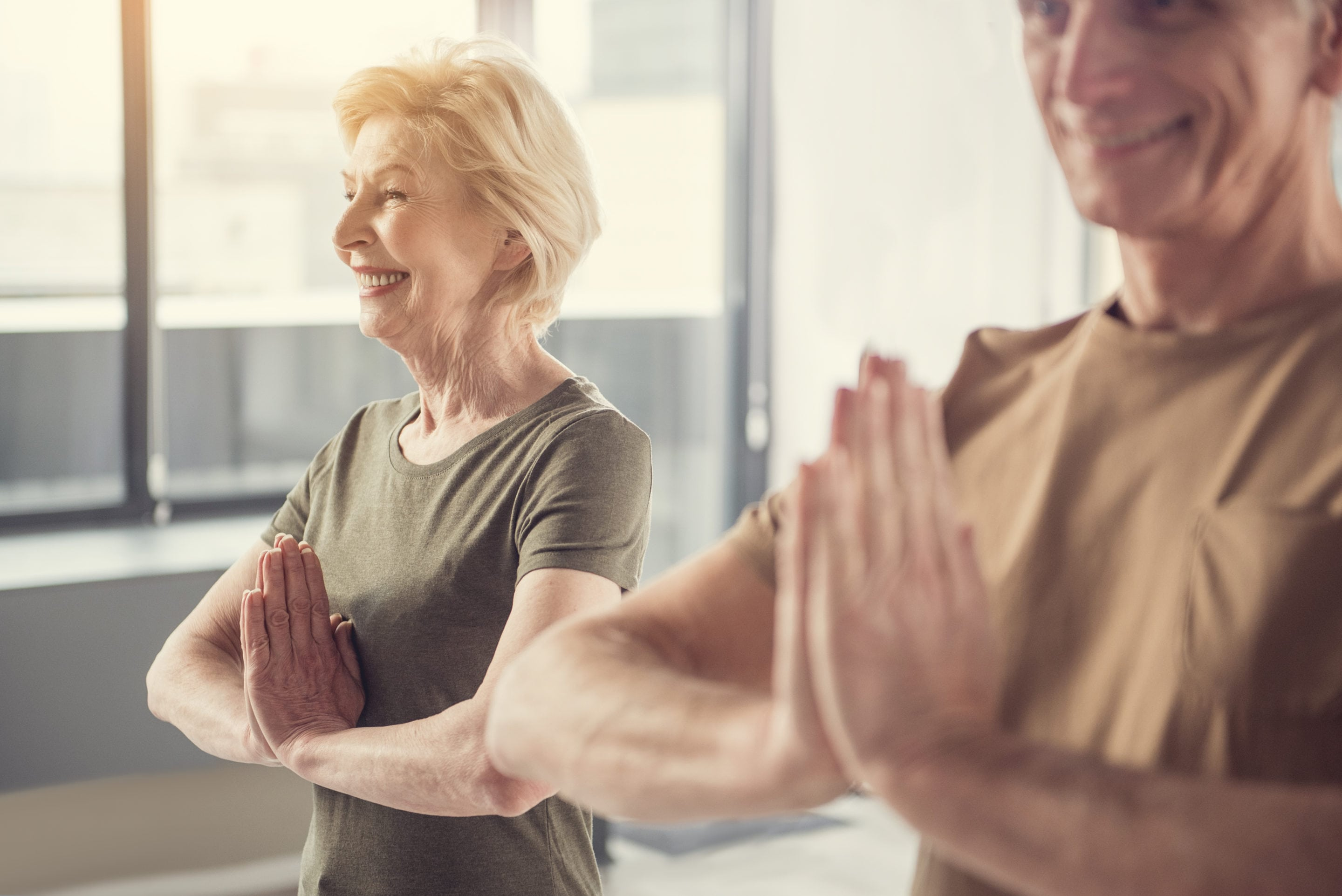 Peaceful retirees attending yoga classes | Beltone Hearing
