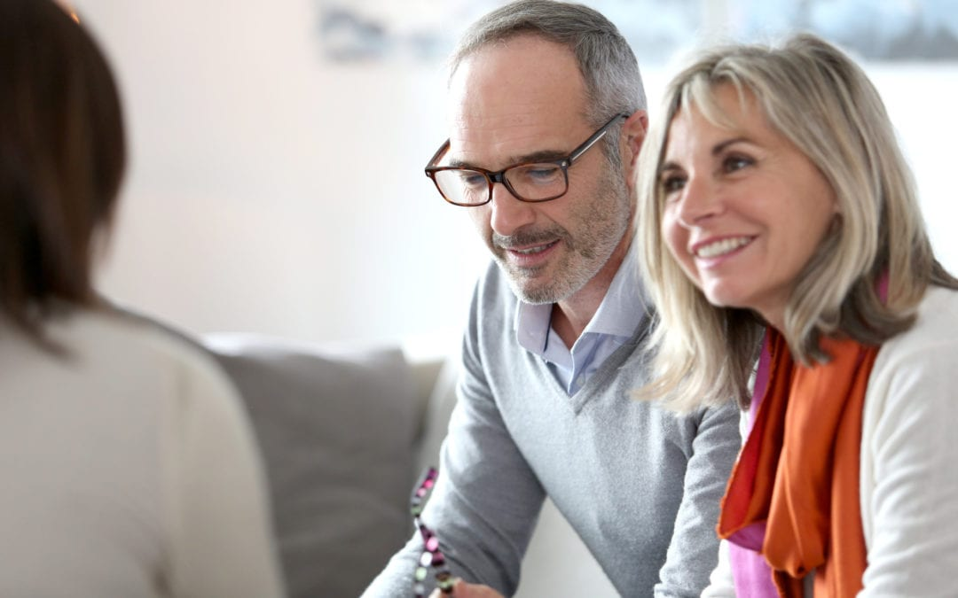 Senior couple meeting financial adviser | Beltone Hearing Aid