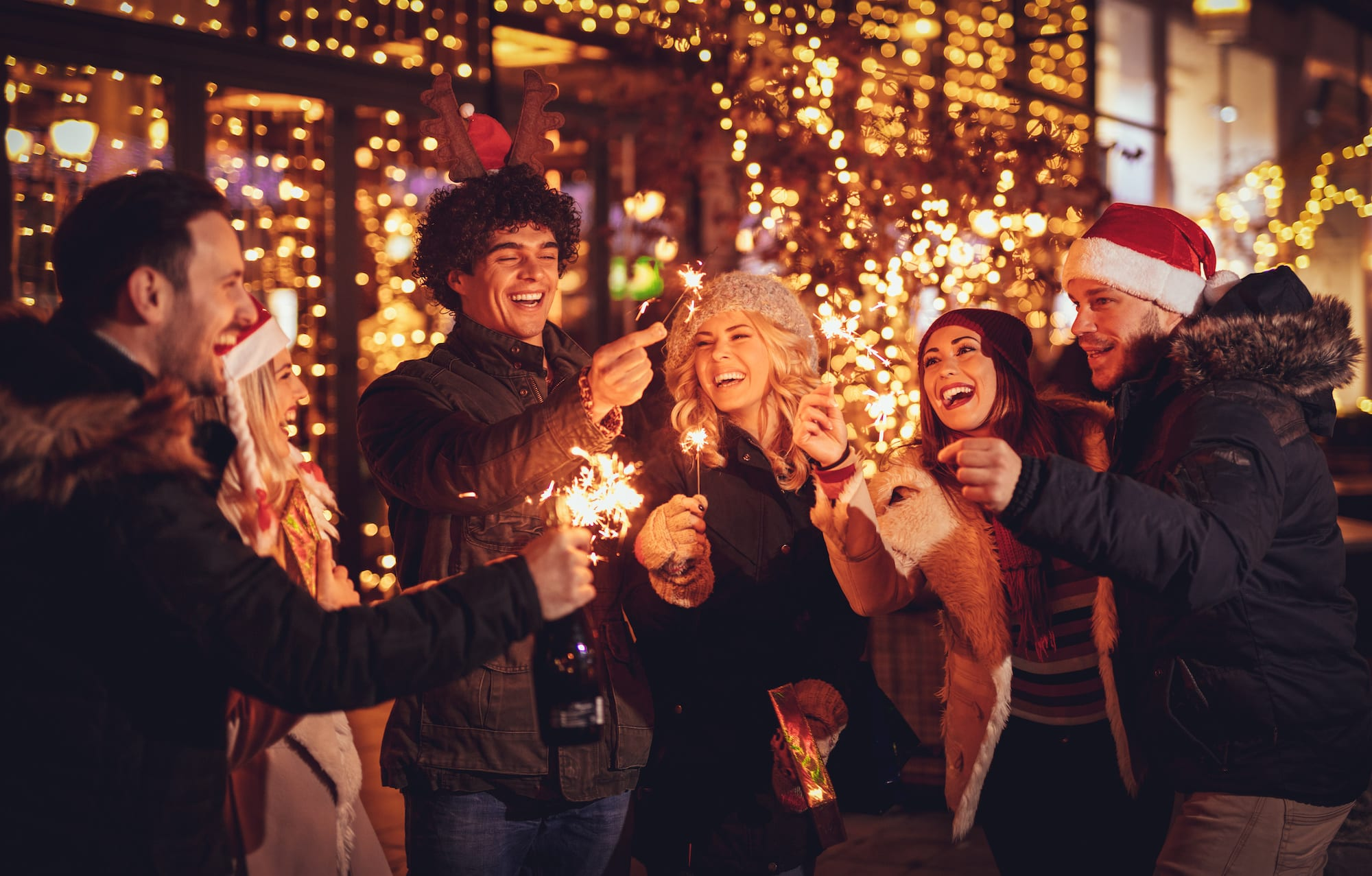 Friends With Sparklers At The New Year Party | Beltone Hearing aid