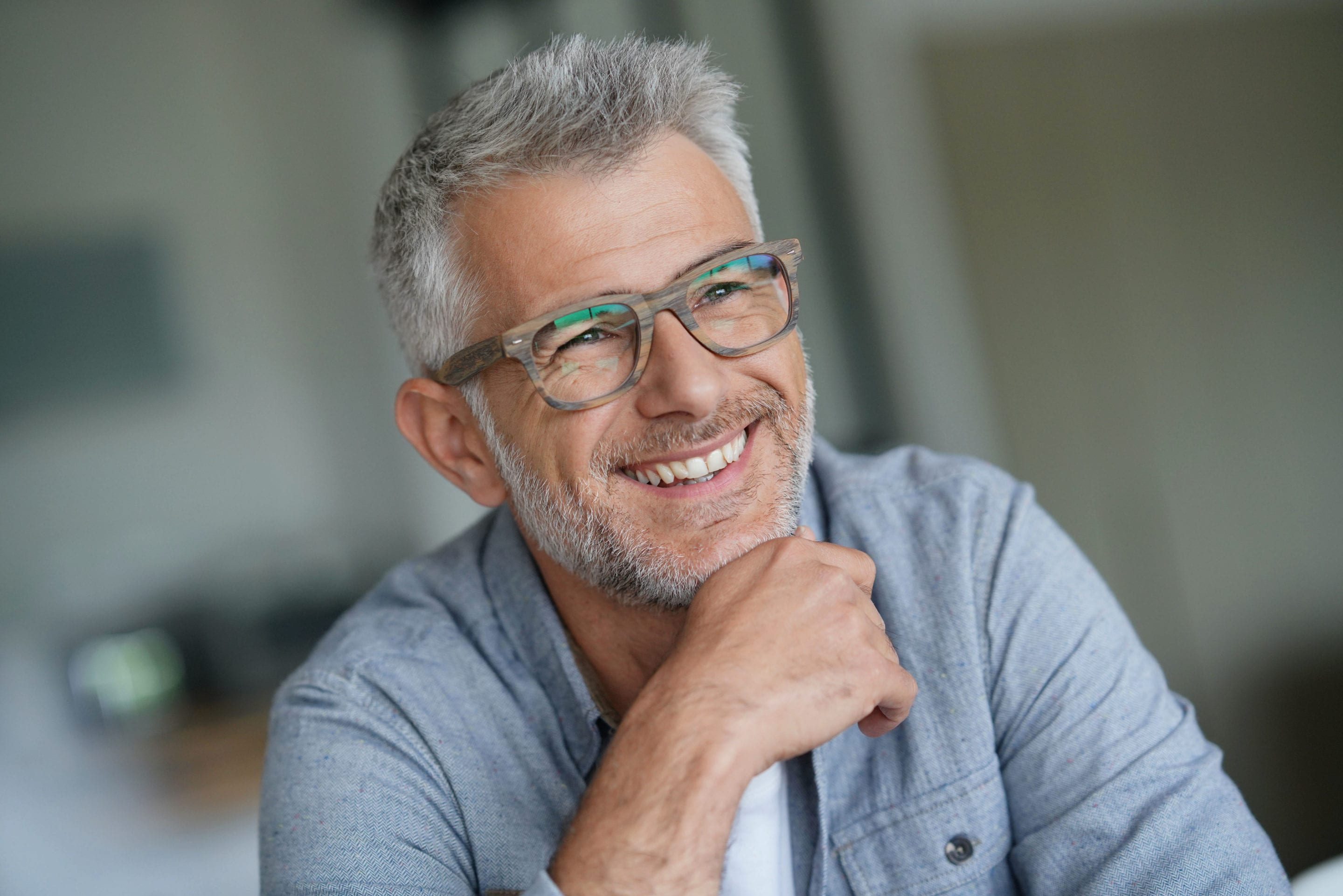 Middle-aged guy with trendy eyeglasses | Beltone Hearing Aid