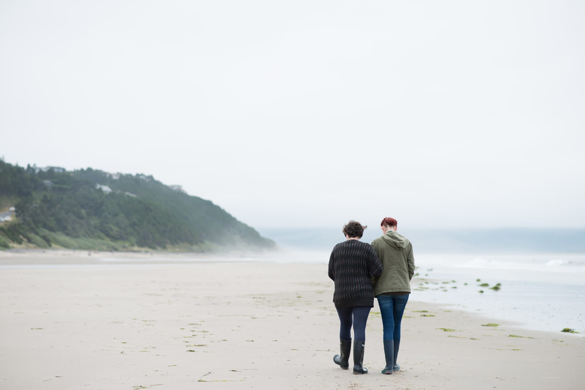 Best friends Taking A Beach Walk | Acadian Hearing Services