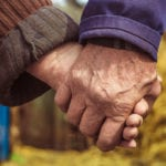 Lovers. Older people hold each other's hands. Warm relations. Peasants. The concept of love in the old age between grandfather and grandmother.   North Houston Hearing