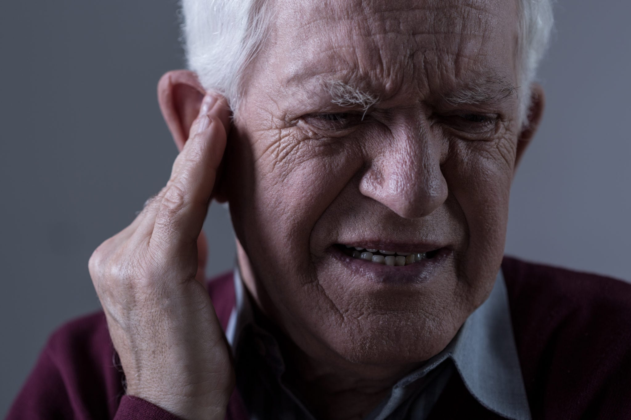 Old man with tinnitus | North Houston Hearing