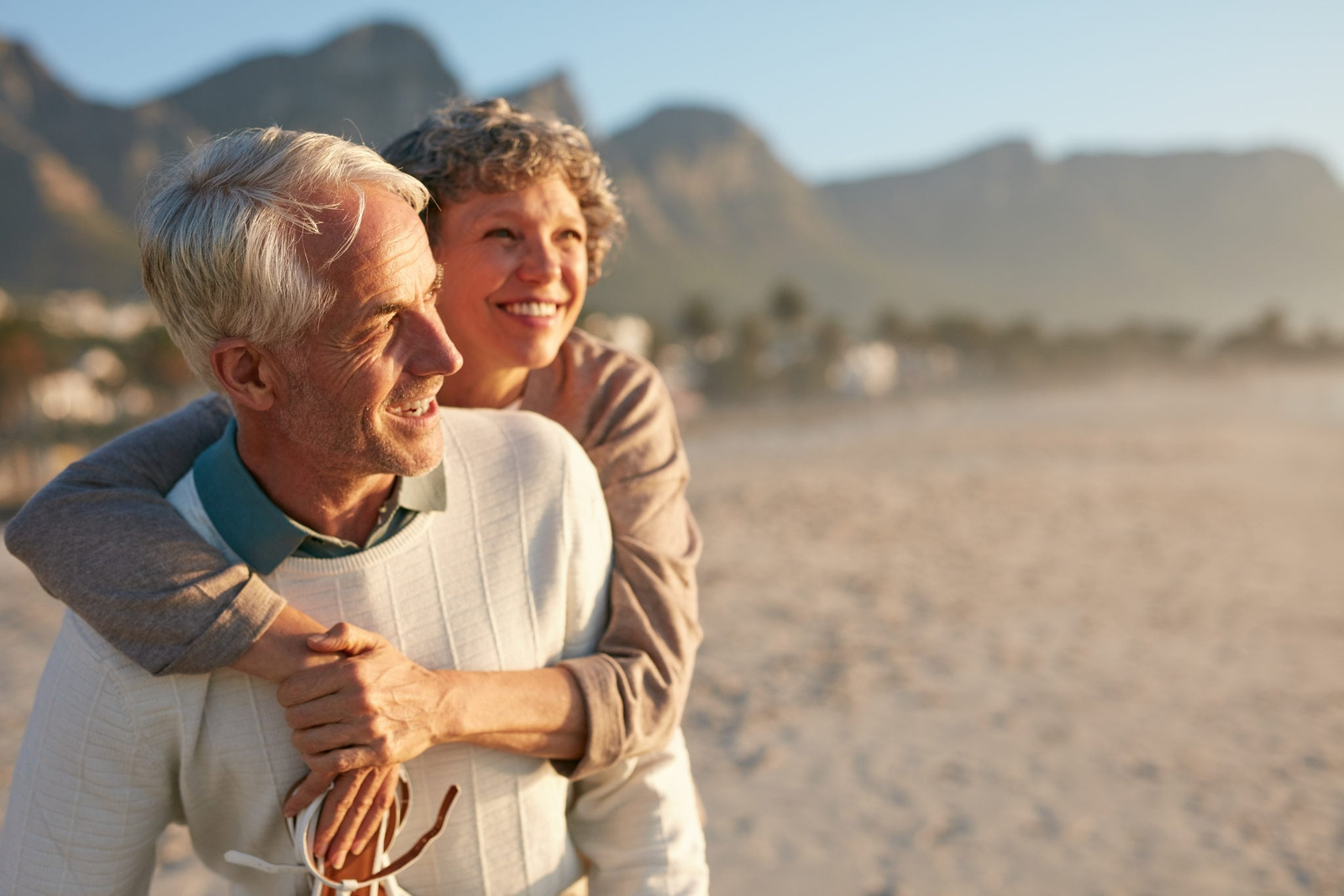 Senior couple enjoying their vacation at the beach | North Houston Hearing Solutions