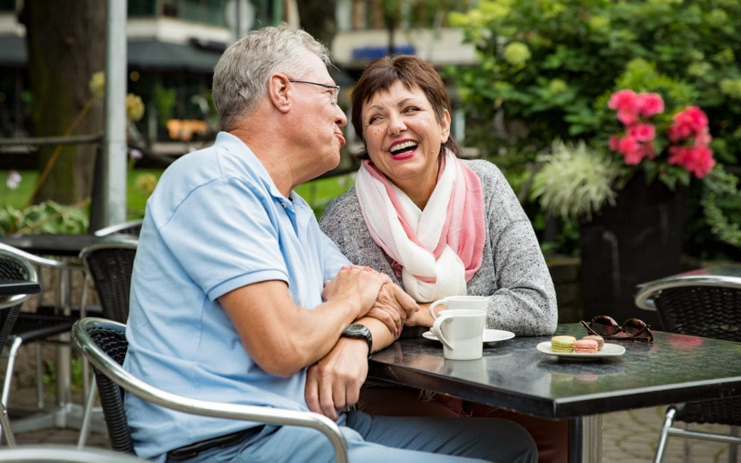 Senior couple in love sitting in street cafe, drinking coffee, talking, laughing and having fun. Happy people in retirement concept. | North houston