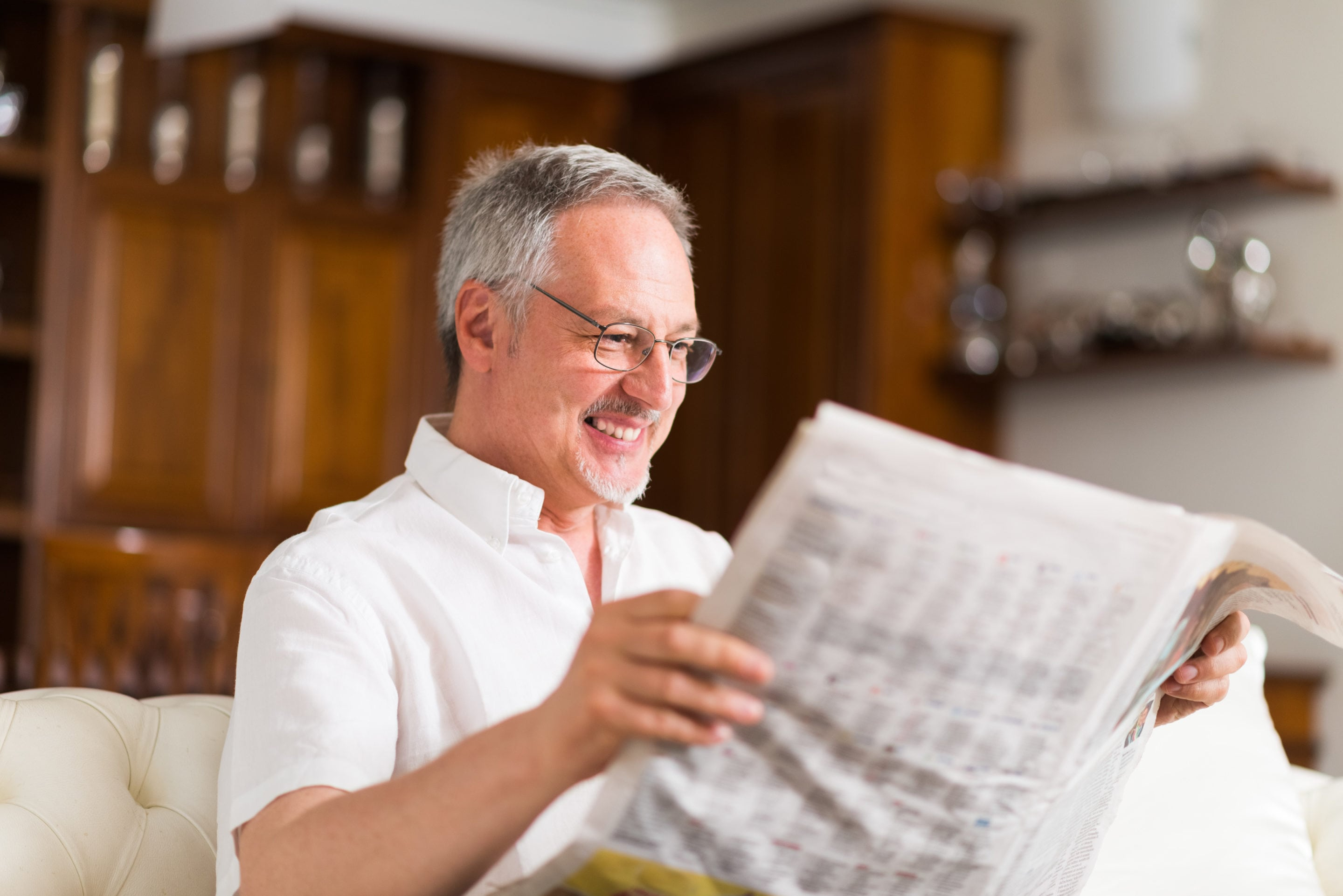Mature man reading a newspaper | SLENT