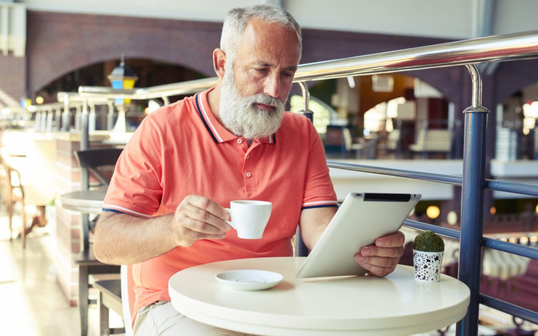 middle-aged serious man drinking coffee | SLENT Hearing & Balance