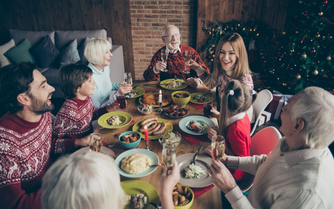 High above angle view of noel diverse family gathering. Cheerful | SLENT Hearing & Balance