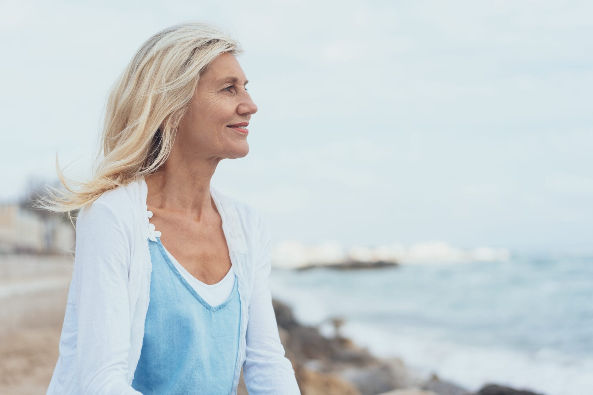 Attractive middle-aged blond woman at the seaside | Dr. Michelle