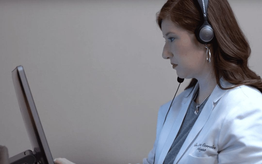 Dr. Christina Corrales performing a hearing assessment