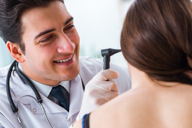 doctor looking into an ear