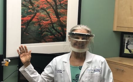 audiologist wearing mask and smiling