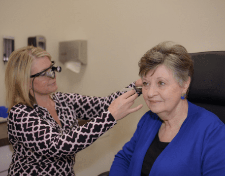 Lady having a hearing assessment