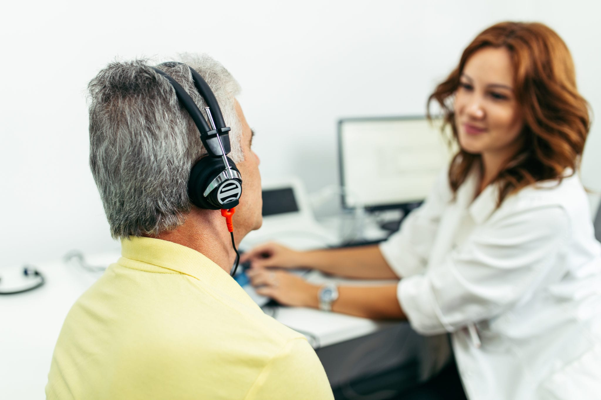 Man having a hearing test from an audiologist