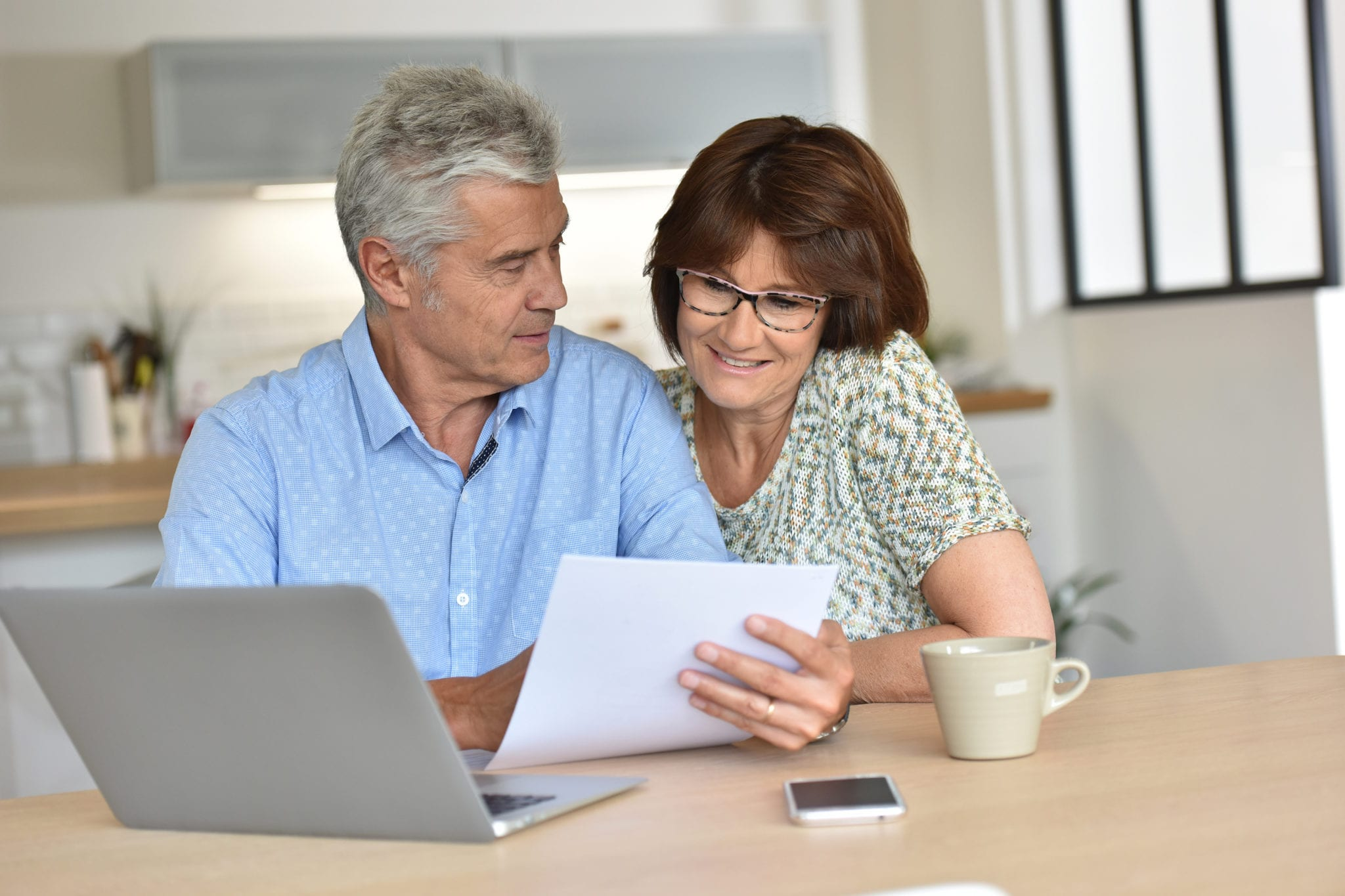 Senior couple using laptop at home | Clarity Hearing