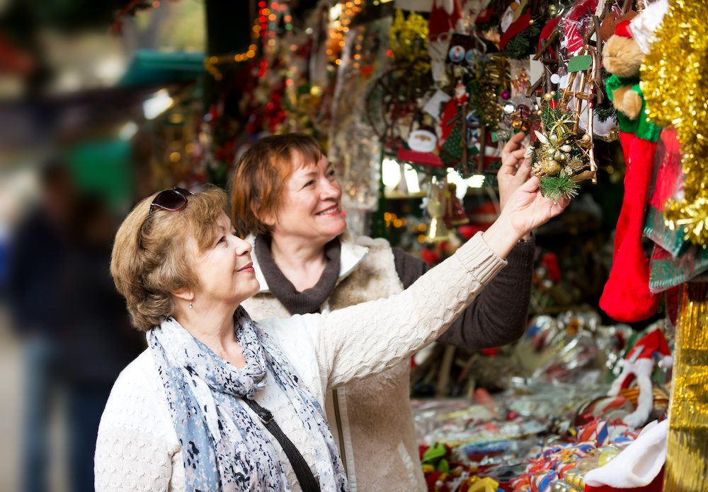 Happy mature women purchasing Christmas decorations | Clarity Hearing