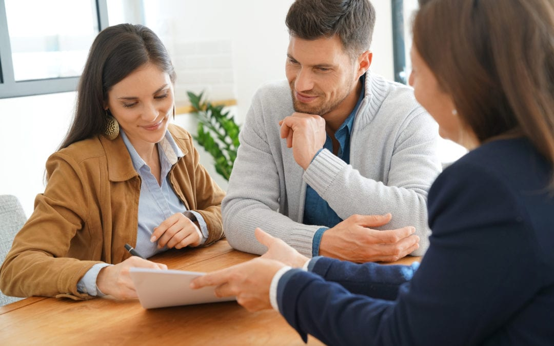 Couple meeting financial adviser for home investment contract | Clarity Hearing