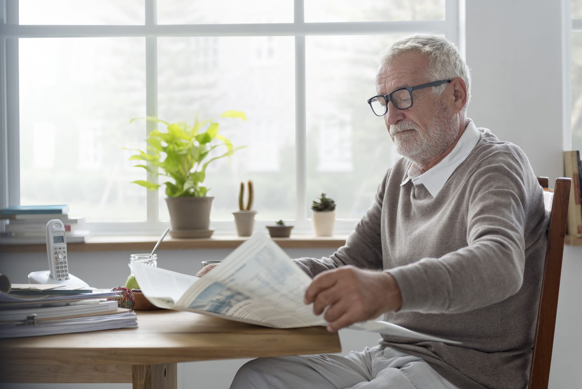 SEnior Adult Readding Newspaper Leisure Concept | Clarity Hearing